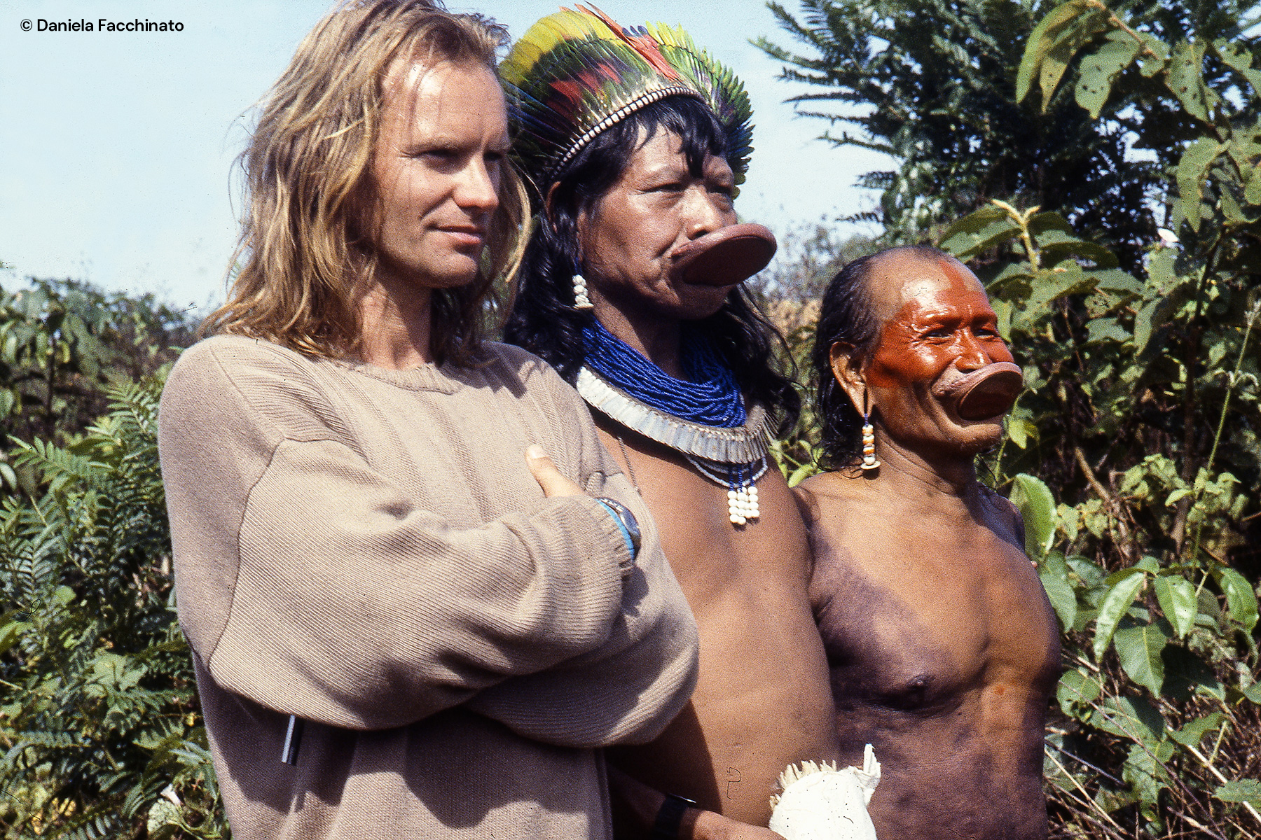 Amazonia, Xingù. Singer Sting with chief Raoni and another tribe dignitary from Kaiapò people