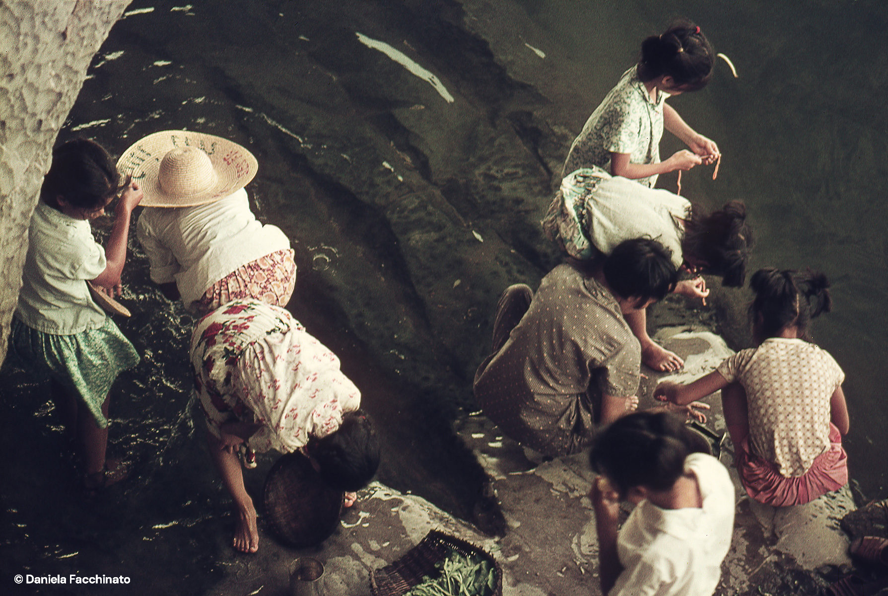 Guilin, Guanxi, China, 1976. Women wash food in the waters of the Li River