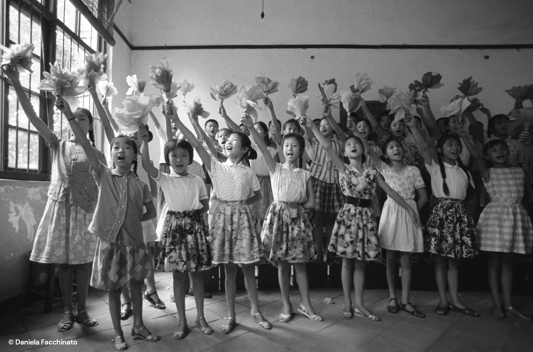 China, 1976. A school class giving a welcome to the italian guests
