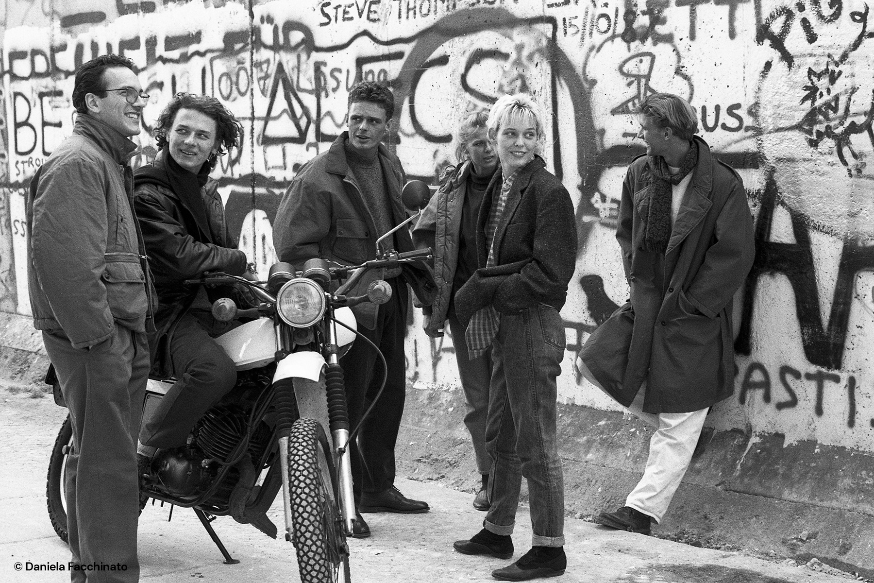 West Berlin 1988. Young people modeling along the wall. Advertising campaign for Massimo Osti