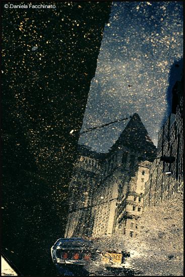 Wall Street Puddles, New York, 1993 © Daniela Facchinato