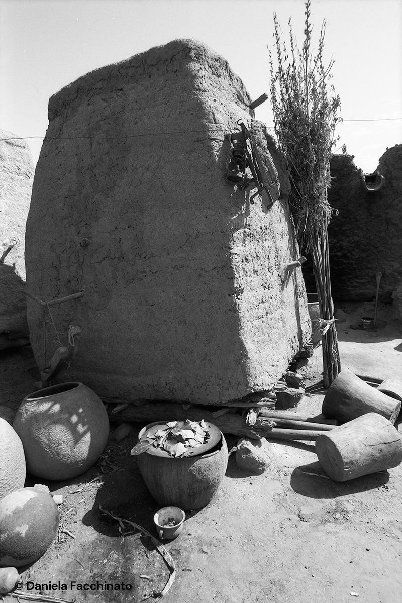 Bambara village, Mali 1989. Mud granary raised off the ground to preserve millet crop
